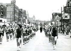 Unknown Parade [perhaps annual State Fair Parade?] on East Walnut Street is what now East Village. Saydel High School marching band shown - 1950's