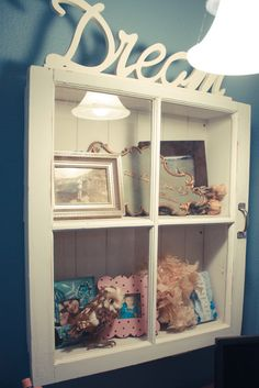 Repurposed window turned into a enclosed shelf...