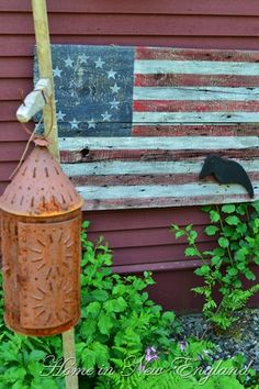 Primitive Americana...handpainted wooden flag...with crow...rusty tin lantern.