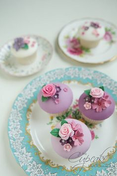 Fabulously pretty floral topped pink and purple cupcakes. #flowers #pink #purple #wedding #birthday #tea #party #food #baking #dessert #cupcakes #cake
