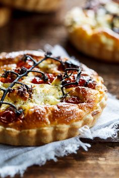 Slow-roasted cherry tomato and peppered goat's cheese quiche. #vegetarian