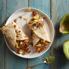 Easy Sausage and Egg Breakfast Burrito  Perfect for a football party or casual daytime affair, these flavorful burritos are filled with fresh peppers, avocado, eggs, Mexican cheese, and Jimmy Dean® Hearty Hot Sausage Crumbles.
