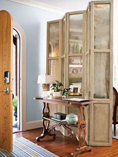 Love the idea of a partition screen to create and entrance hall in a small space.