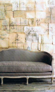 pages on wall. Grey Settee.