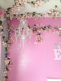 Baby girl nursery idea - with better quality flowers/garland!