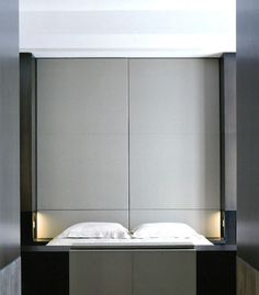 {This project by French Minimalist Olivier Lempereur, while beautifully executed (I know it looks simple, but there are some pretty complex details here), is almost too minimal for me. Needs some soul you know? Still, I have to commend the masterful use of materials and the restrained palette.}