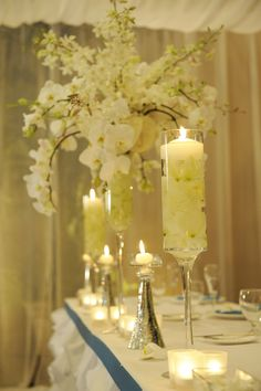 All white wedding reception centerpieces with white votive candles