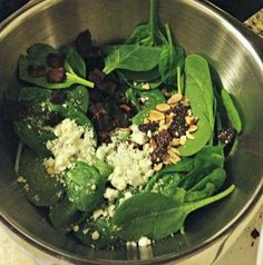 Spinach salad with dried cherries and bleu cheese and warm bacon vinaigrette