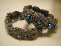Free crochet/beaded bracelet pattern- I would use a different yarn because this one hides the beauty of the stitch.