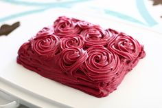 chocolate cake with blackberry buttercream frosting.