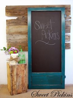 "Screen door with screen removed and replaced with a board covered in chalkboard paint, then door frame is painted this really neat color. (""Intense Teal"" by Sherwin Williams with a dark brown glaze)"