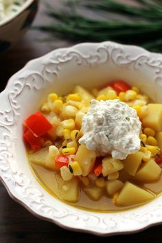Just because it's summer doesn't mean soup season is over! This light corn chowder is stuffed with summer vegetables and fresh clean flavors, and topped with a dollop of chive-infused ricotta for a hint of indulgence.