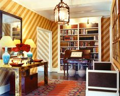 A striped entry way designed by Markham Roberts in the designer's latest book, Decorating: The Way I See It