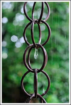 Rain Chains-a beautiful and functional alternative to traditional, closed gutter downspouts. Guiding rain water visibly down chains or cups from the roof to the ground, rain chains transform a plain gutter downspout into a pleasing water feature. From the soft tinkling of individual droplets to the soothing rush of white water, they are a treat to listen to.