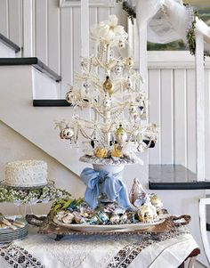 Always a fan of the gold, champagne, silver, and white glass balls.  Also like the beaded garland.