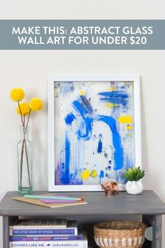 Glass wall art for under $20? Don't mind if we do! Here's how to create a layered, abstract, one-of-a-kind piece of wall art.