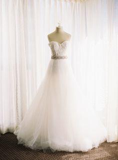 #monique-lhuillier  Photography: Caroline Tran Photography - carolinetran.net  Read More: http://www.stylemepretty.com/2013/12/31/elegant-san-francisco-wedding-at-bentley-reserve/
