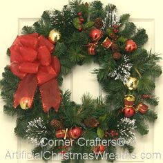 "Thin Christmas Wreath - 2013 - GREAT FOR STORM DOORS! Our ""Thin Christmas Wreath"" is a tasteful blending of pine cones, snow tipped firs, red berries, Christmas balls and a beautiful red bow. This wreath is only (app.) 3"" in depth which should be thin enough to fit between storm doors! - #ThinChristmasWreaths #ChristmasWreaths #ArtificialChristmasWreaths #Wreaths #Wreath"