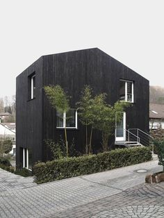 ARCHITECTURE | DETAILS | EXTERIOR | Image Credit: zwei kleine Häuser ++ architekturbüro scheder - lovely house exterior, would of preferred the non contrast window and door frames, handsome none the less. #exteriors #houses #details #black