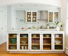 This multi-use peninsula has us envious of all the beautiful extra storage! More small kitchen ideas: http://www.bhg.com/kitchen/small/small-white-kitchens/?socsrc=bhgpin013014multiusepeninsula&page=17