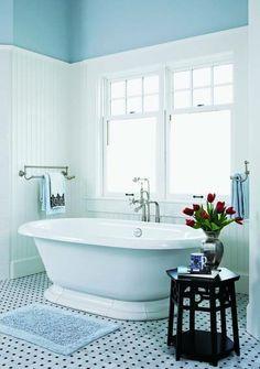 classical light blue bathroom interiors, like the white and black tile floor too