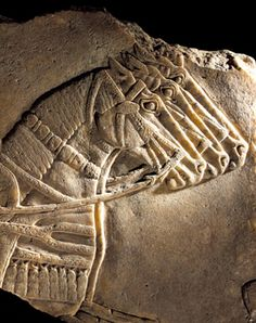 9th C. BCE.  The horses' eyes highlight the early use of perspective in bas-relief. Neo-Assyrian fragment north-west palace Nimrud.