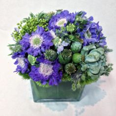 Flower arrangement with succulents.  http://www.parkerspetals.com/ or email me at jaime@parkerspetals.com