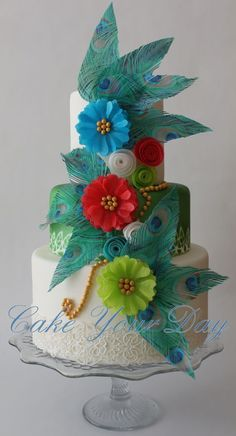 Decorations made of wafer paper and edible lace. Peacock feathers/flowers cake