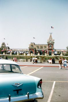 Disneyland parking lot, 1956. It's crazy how much Disneyland has changed! The parking lot is now the shuttle transit center and the area between Disneyland and California Adventures.