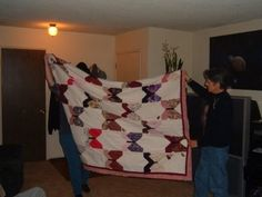 This is a quilt that I made for my mom.  All Hand Quilted with stemmed roses on each of the muslin blocks.
