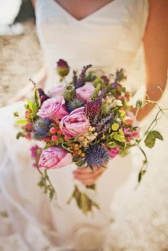 Colorful and organic bridal bouquet with shades of green and pink - photo by Ryan Flynn Photography