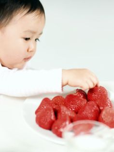 Has your baby started solids? Know what foods to avoid feeding your baby when introducing new foods at WhatToExpect.com.