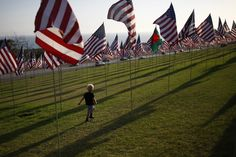 A boy runs among flags flying at Pepperdine University in honor of the victims of the Sept. 11, 2001 attacks against the United States on Sept. 10, 2012 in Malibu, Calif. Nearly 3,000 flags for of each person killed that day were erected. The installation of flags has been an annual event since Sept. 2011 and will remain on display until the close of Pepperdine's 75th anniversary celebrations on Sept. 19 (David McNew/Associated Press)