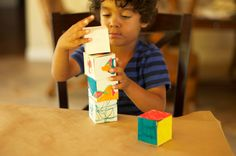 Make paper blocks that your child has decorated.