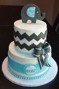 Elephant Chevron Cake - Baby shower cake. The hostess brought me a photo that she wanted. Cake covered in buttercream with fondant details. Fondant elephant and bow too!