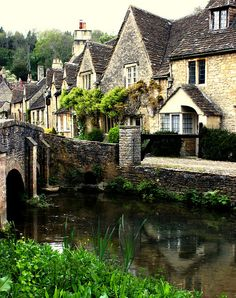 Cotswold style houses along the Bybrook river at Castle Combe