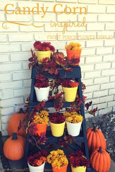 #DIY Candy Corn inspired #Fall flower display (using Outdoor #ModPodge to seal)