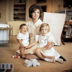 Jackie looks after John Jr. and Caroline at the White House in 1961.