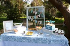 Use an old window (from flea market) and dress up with fun bunting for an adorable and chic dessert table! #babyshower