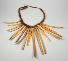 Alaska | Necklace with bone pendants from the Tlingit people | 19th century | bone, vegetable fiber and string.