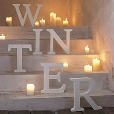 Winter Candles-great way to block off a staircase for a holiday party.
