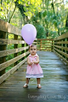 First Birthday Photo.  One year= one balloon.  Take this picture each year with an additional balloon.