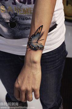 Realistic butterfly landing tattoo <3
