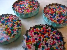 Bottlecap Magnets. We used 3D lacquer to top them off, Tacky glue to do magnets on back. 1 inch round punch was just right - get the kind with an open bottom so you can perfectly line up your picture.