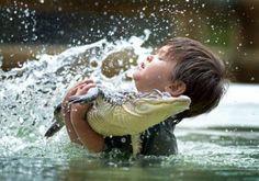 That's how kids play in Australia. If your kid isn't up to wrestling gators, DON'T BRING THEM THERE. anim, crocodiles, dinosaur, news, australia, charli parker, children, alligators, kid
