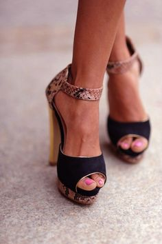 Ankle strap platform sandals.  LOVE the snake accents!
