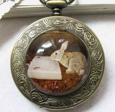 Beautiful Bunny reading a Book Watch Necklace.  size:  chain : 80 cm long (31.49 inchs)(the length of the chain can be changed according your need)  Pocket watch: 4.7cm (1.85 inchs) (Diameter)  This watch actually work and keep time.  You can adjust the time by pulling up the knob and turning it.  This pocket watch is from my art work.  You can visit my Art work shop:  http://www.zeng.etsy.com