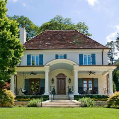 French style home with veranda...