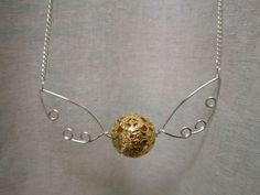 snitch necklace: could also use wing shaped beads instead of wire wings