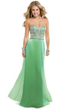 This little number gives new meaning to the term rock band, with thick bands of sparkling rhinestones covering the bodice! | Flirt #jade #promdress #prom #flirtprom